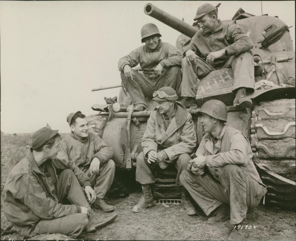 Ernie Pyle (center with goggles) and a crew from the US Army's 191st Tank Battalion